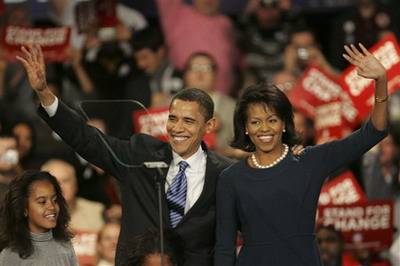 Democratic presidential hopeful, Sen. Barack Obama D-Ill., and his wife Michelle and daughter Malia, left, celebrate with his supporters after his victory in the Iowa caucus Thursday, Jan. 3, 2008, in Des Moines, Iowa. (AP Photo/Rick Bowmer)