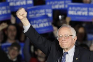 U.S. Democratic presidential candidate Bernie Sanders raises as fist as he speaks at his caucus night rally Des Moines, Iowa on February 1, 2016, Photo courtesy of REUTERS/Rick Wilking