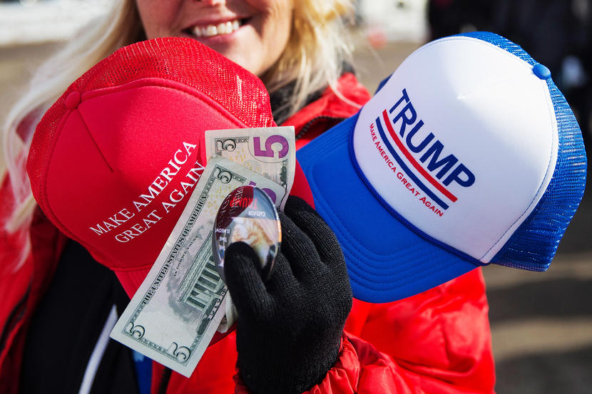 DUBUQUE, IA - JANUARY 30: A vendor sells merchandise outside a rally for Republican presidential candidate Donald Trump at the airport on January 29, 2016 in Dubuque, Iowa. Trump is in Iowa trying to gain support in front of the state's February 1 caucuses. (Photo by Scott Olson/Getty Images)